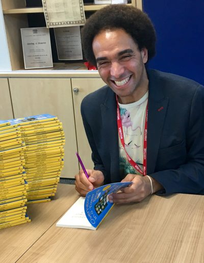 Joseph Coelho signs his books at a school visit