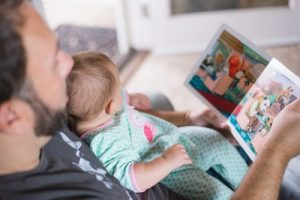 Bookwagon Dad and baby reading